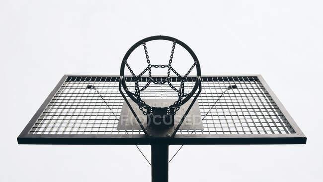 View from below metal basketball backboard and hoop — Stock Photo