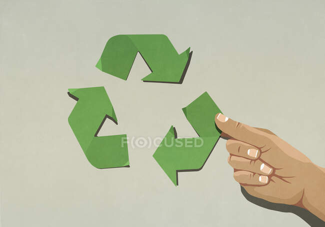 Cropped view of woman arranging green recycling arrow symbol — Stock Photo