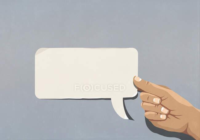 Homem segurando bolha discurso em branco — Fotografia de Stock