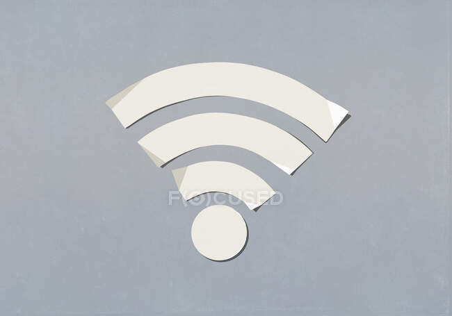 Paper wifi symbol on grey background — Stock Photo