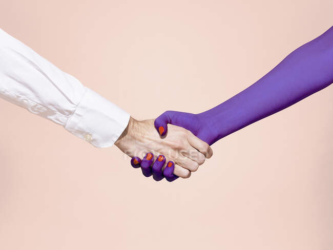 Abstract handshake on pink background — Stock Photo