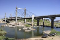 View of Anegondi Bridge over water with stones during daytime, Karnataka, India — Stock Photo