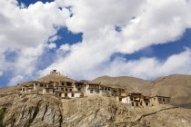 Meditation cells of the Lamayuru Buddhist Monastery rising above a mass of eroded cliffs on the Leh-Kargil road. Ladakh. India — Stock Photo