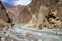 A stream cutting across the rocky mountains of Ladakh. India — Stock Photo