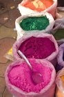 Colors for sale in sacks — Stock Photo