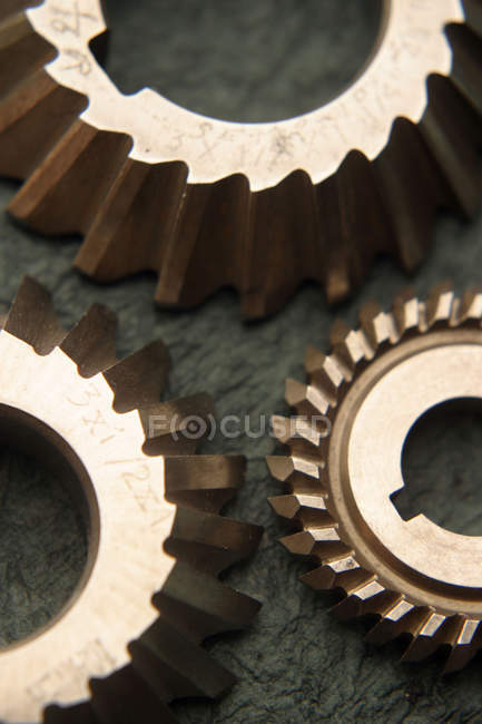 Wheels laying near each other over dark green blurreed background — Stock Photo