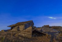 Building ruins with bright bolide meteor — Stock Photo