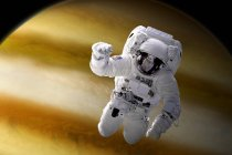 Astronaut floating in space above large, alien planet — Stock Photo