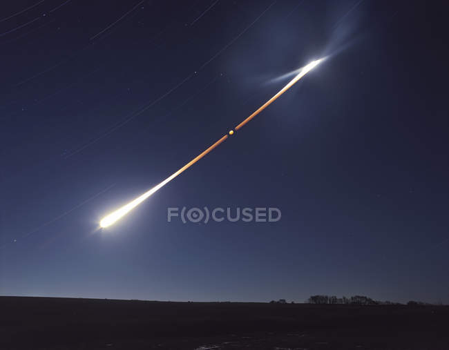Total lunar eclipse with motion trail — Stock Photo