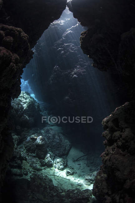 Sunlight in submerged cavern on reef — Stock Photo