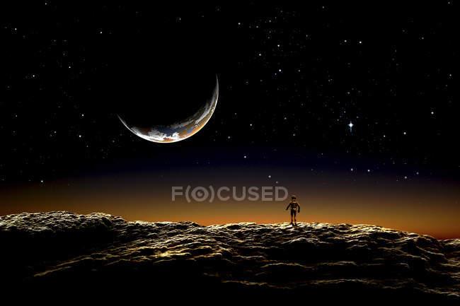Астронавт, стоячи на безплідною планеті — стокове фото