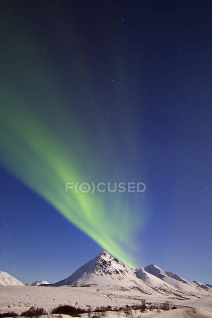 Aurora borealis over Ogilvie mountains — Stock Photo
