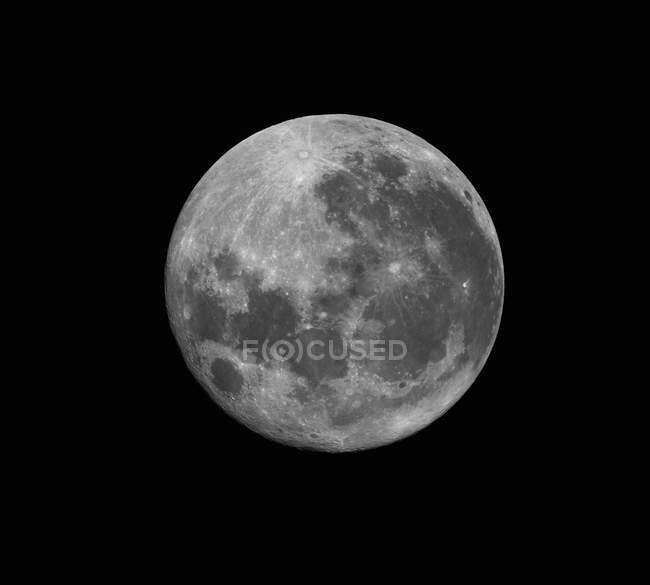 Full moon in high resolution on black background — Stock Photo