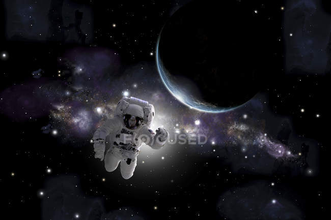 Astronaut floating near Earth-like planet in outer space — Stock Photo