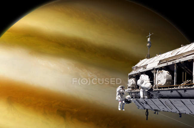 Team of astronauts performing work on space station while orbiting large alien planet — Stock Photo