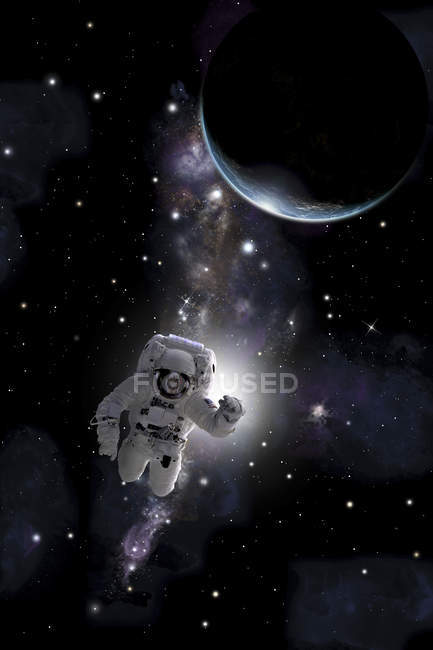 Astronaut floating in outer space near  Earth-like planet - foto de stock
