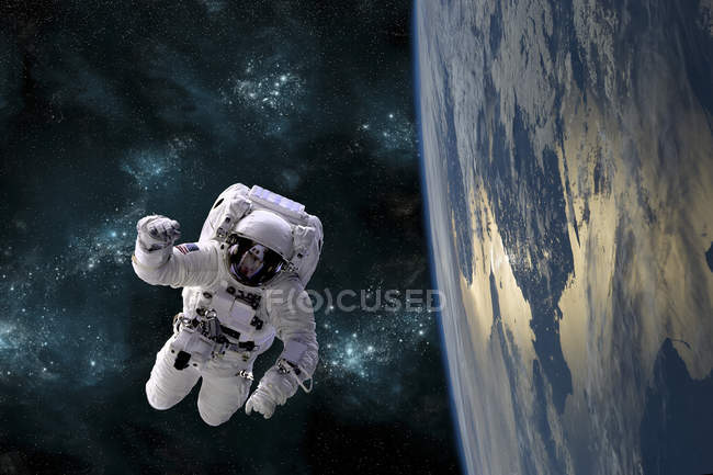 Astronaut floating in space while orbiting large Earth-like planet — Stock Photo