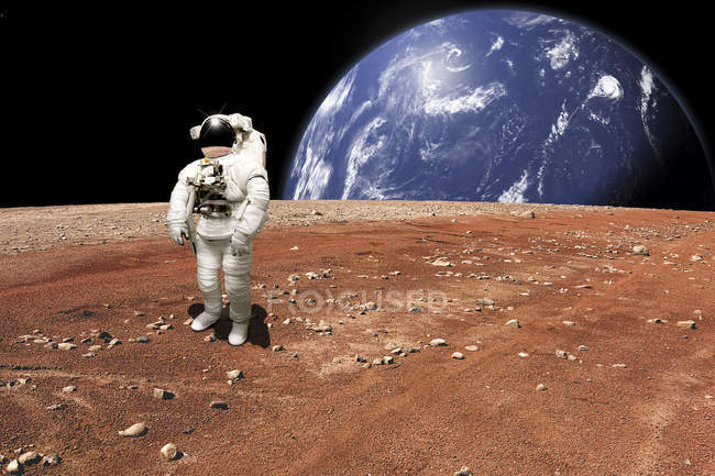 Astronaut reviewing situation after being marooned on barren planet — Stock Photo