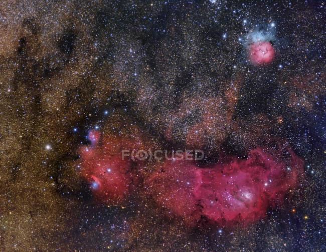 Sagittarius Triplet featuring Lagoon Nebula, Trifid Nebula and NGC 6559 in high resolution — Stock Photo