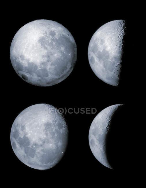 Чотири фази місяця на чорному фоні — стокове фото