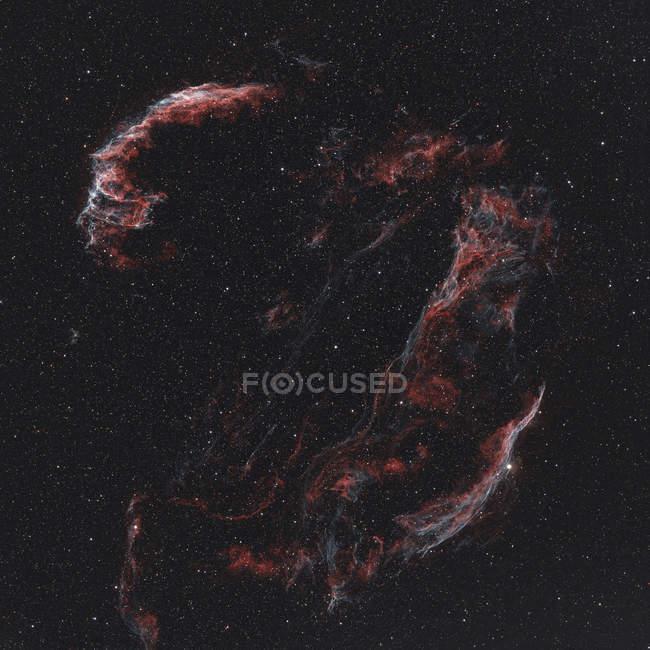 Nebulosa del Velo que muestra Nebulosa del Velo Oriental, Nebulosa del Velo Occidental y Wisp Triangular de Pickering - foto de stock