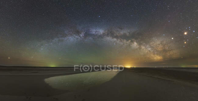 Arch of Milky Way above salt lake, Russia — Stock Photo