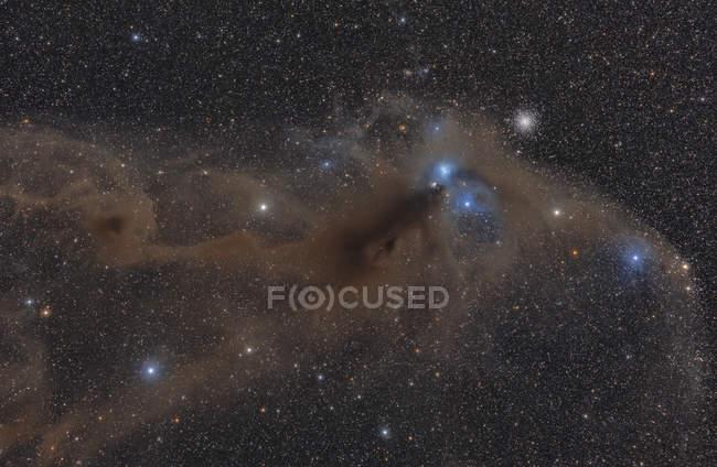 Dark nebula in constellation of Sagittarius and globular cluster NGC 6723 — Stock Photo