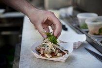 Man hand preparing hamburger in box — Stock Photo