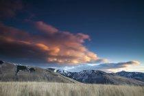 Clouds Glow pink over Mount Jumbo and Mount Sentinel near Missoula, Montana. — стокове фото