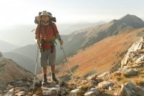 A backpacker stands by Crystal Peak near Pemberton, British Columbia, Canada — Stock Photo