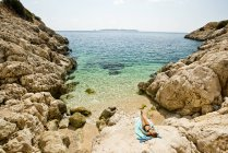 Young woman sun bathing on Mediterranean Sea near Kas, Turkey. — стокове фото