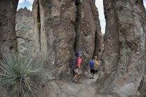 Man and woman backpackers explore the rock formations at Fremont Saddle on the popular Peralta Trail in the Superstition Wilderness Area, Tonto National Forest near Phoenix, Arizona November 2011.  The trail offers spectacular views of Weavers Needle — Stock Photo