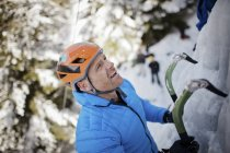 A ice climber looks for his next hold in Whistler, British Columbia, Canada. — Stock Photo