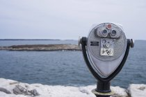 Close up view of binoculars at Reid State Park and ocean on background — Stock Photo