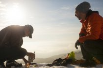 Two climbers converse while  cooking breakfast in the mountains of British Columbia, Canada. — Stock Photo