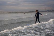Boy Surfing At Nahant Beach In Nahant, Massachusetts — Stock Photo