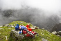 Male hiker resting in grassy field near Verbier in Swiss Alps — Stock Photo