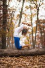 A Woman Doing Yoga During Autumn In New England — Stock Photo
