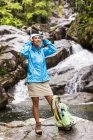 Portrait Of Woman Wearing Jacket In Front Of Waterfall And Creek — Stock Photo
