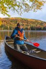 Portrait of man in Canoe On Greenough Pond In New Hampshire — Stock Photo