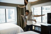 Young Cute Couple Makes Fun In Hotel Room — Stock Photo