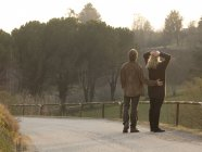 Mature couple pause on country road — Stock Photo