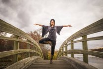 Woman On Footbridge Doing Yoga In Autumn In New England — Stock Photo