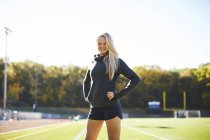 Portrait Of A Female Athlete Standing On The Ground — Stock Photo