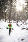 A guy and his dog on a sunny winter day walk through Chautauqua Park in Boulder, Colorado. — Stock Photo