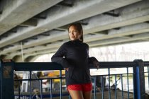 Portrait of an asian american woman in athletic clothing — Stock Photo