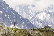 Girl trail running in Chamonix around Chesery lake — Stock Photo