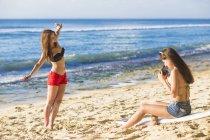 Girls taking photo and fun at beach. — Stock Photo