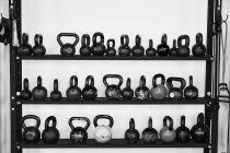 Rack of kettlebells used for weight training — Stock Photo