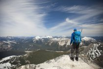Backpacker standing at summit of Needle Peak, Hope, British Columbia, Canada — Stock Photo
